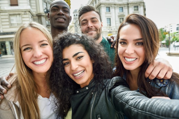 multi ethnic group of cannabis loving friends embracing